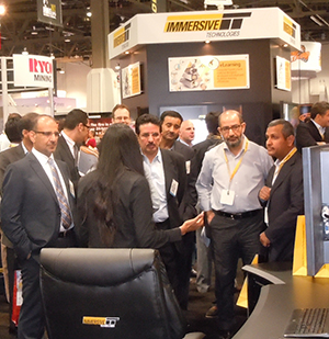 Representatives from Ma'aden visit the Immersive Technologies stand at MINExpo 2012 in Las Vegas.
