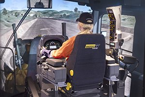 Immersive Technologies' new simulator module includes a complete replica cab of the Caterpillar 24M Motor Grader, with fully functional controls and instrumentation sourced directly from Caterpillar. The combination dash mounted instrument cluster and the CAT Advisor Messaging System provide key machine operating information and give the operator insight into the machine's operation and maintenance needs.
