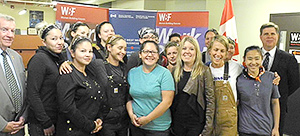 WBF students at announcement of investment to expand the Women Building Futures' (WBF) Heavy Equipment Operator (HEO) Program
